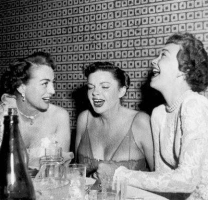 Crawford, Garland & Wyman in stitches. Were they discussing Bette Davis?