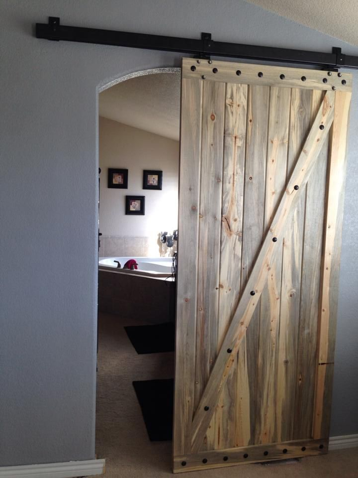 Barn door in our master bedroom/ master bath made from Colorado beetle kill wood.