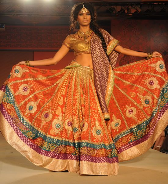 Rita Kumars fashion highlights the heritage of craftsmanship that India is renowned for. Her collections consist of exquisitely embroidered lehengas, saris, coats, kurtas, shararas and skirts.