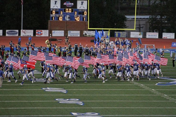 FOX NEWS: EPIC! Entire high school football team runs onto field with American flags!