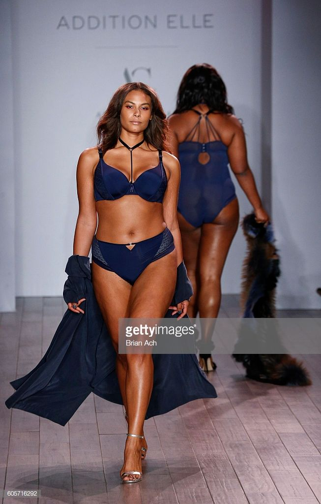 7e151a65b7029 A model walks the runway at the Addition Elle Presents Holiday 2016 RTW + Ashley  Graham Lingerie fashion show during Style360 Fashion Week September 2016 at  ...
