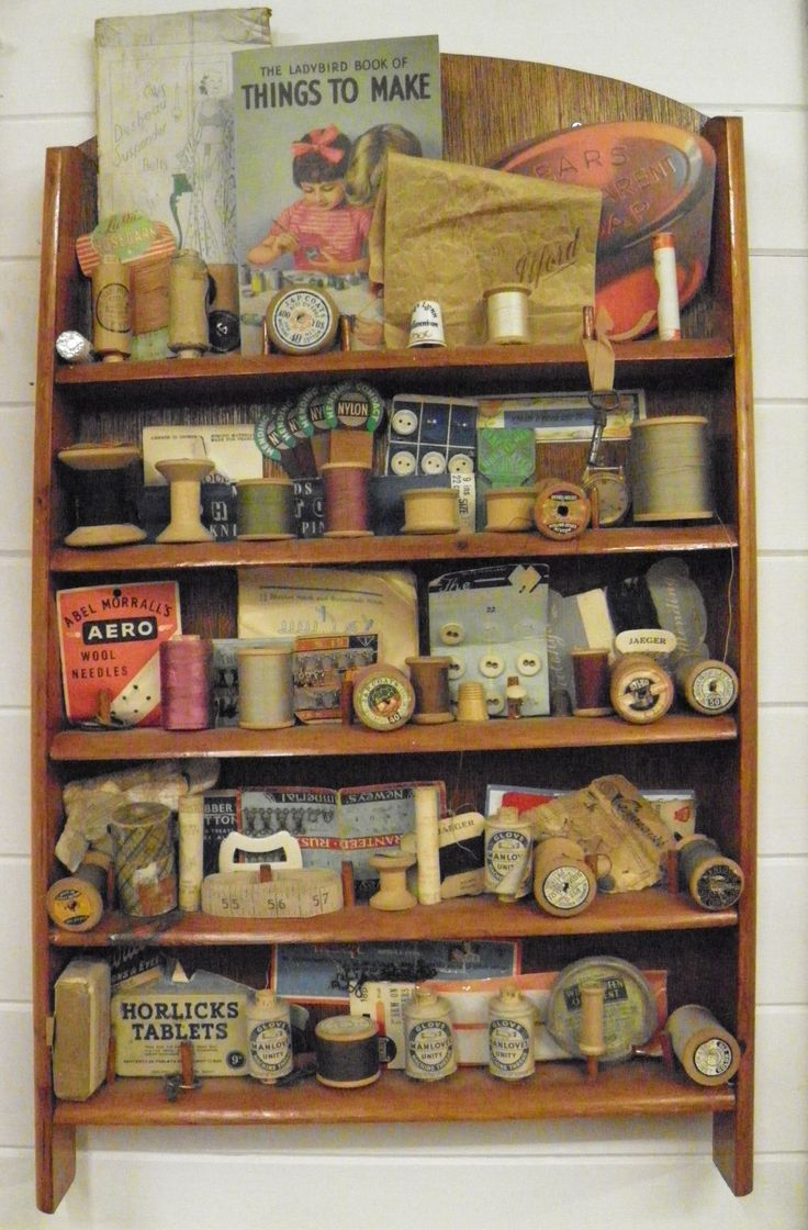 Vintage/Antique sewing supplies. Love the way it is displayed so you are looking at something different all the time.