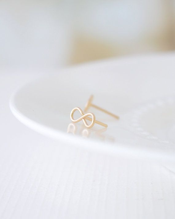 Tiny Infinity Stud Earrings are handmade by Olive Yew in gold and silver.