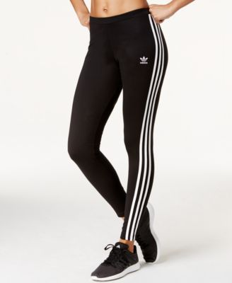 With the traditional three-stripe insignia and a sleek stretch fit, these adidas Originals leggings combine the best of classic and contemporary.   Cotton/spandex/elastane   Machine washable   Importe