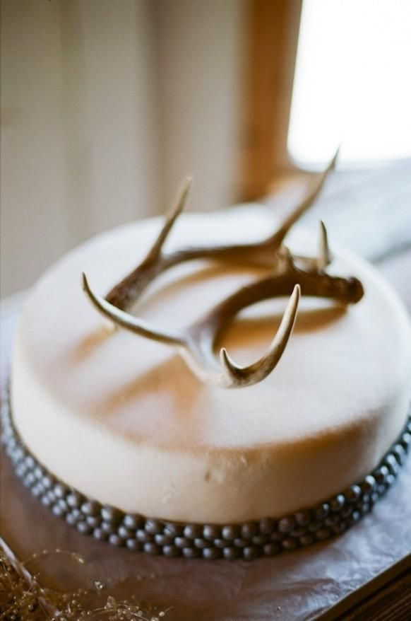 A simple cake with an antler on top is really gorgeous for a low-key groom's cake