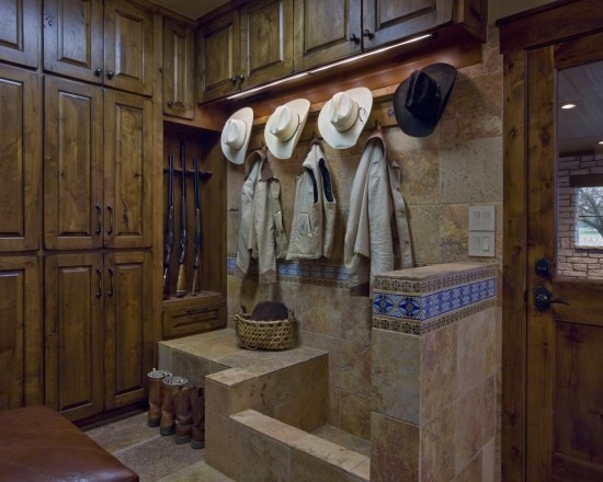 Cowboy mud room Love this with snow it would be one way to keep it fro getting all over the house!  This is WYOMING!