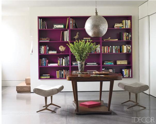 Purple bookshelves in a white room