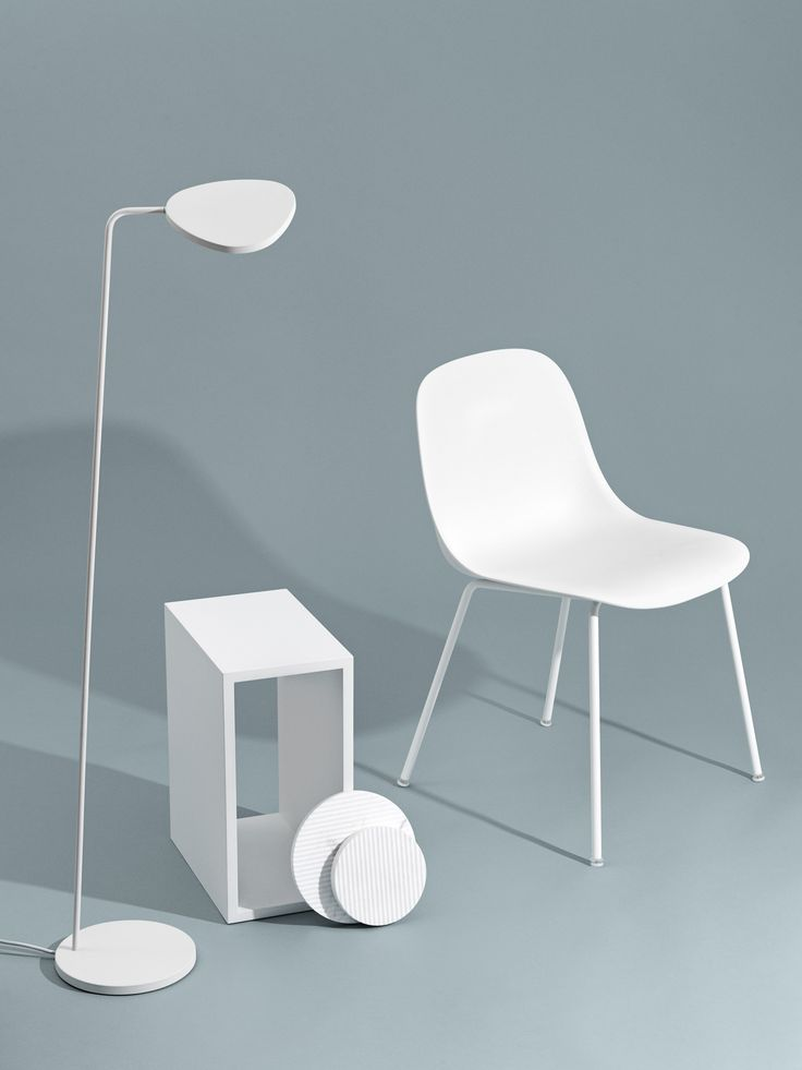 Muuto - Concept. A masculine yet delicate look is achieved by using white design pieces on a darker background.