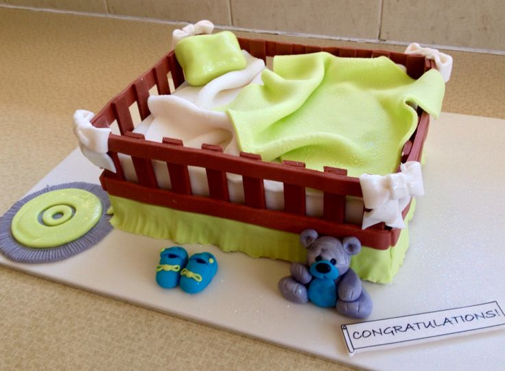 Lime, blue and white baby crib cake