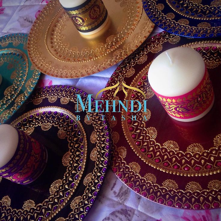 Order of 5 thaals with small candles wrapped with indian ribbon #mehndibytasha #hennaartist #mehndiartist #colourful #mehndi #mehndithaal #thaal #hennaplate #decor #wedding #weddingthaal #mehnditaal #engagement  #chargerplate #love #instagood #indiandecor #picoftheday #photooftheday #intricate #indianribbon #weddingdecor #candles #indian #beautiful #ZUKREAT