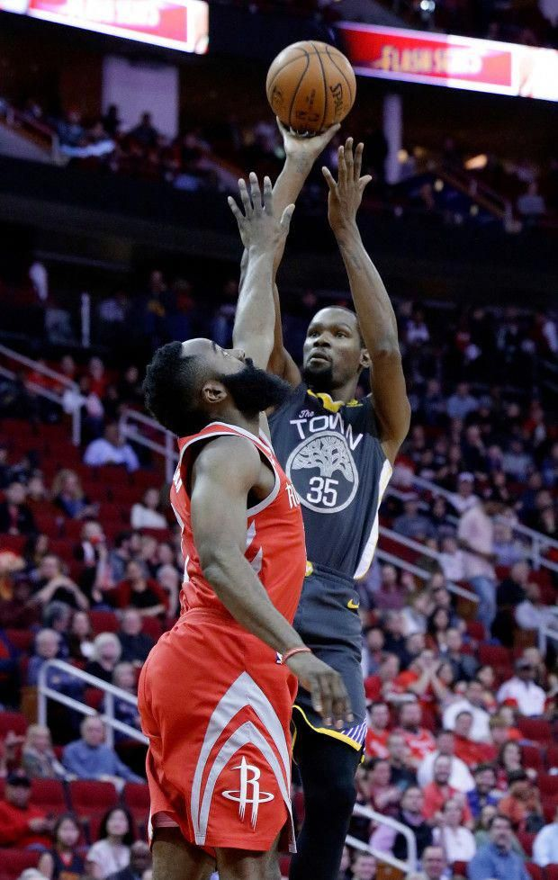 Golden State Warriors forward Kevin Durant (35) puts up a shot over Houston  Rockets guard James Harden (13) during the first half of an NBA basketball  game ... 208c7dcf4