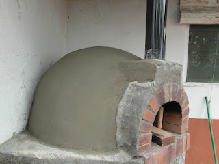 Wood fired brick and mortar oven