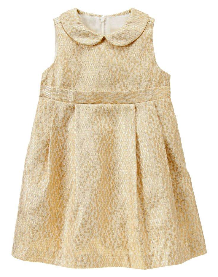 "Note this isn't as ""GOLD"" and bright as in the photo here.  Gold Brocade Dress at Gymboree"