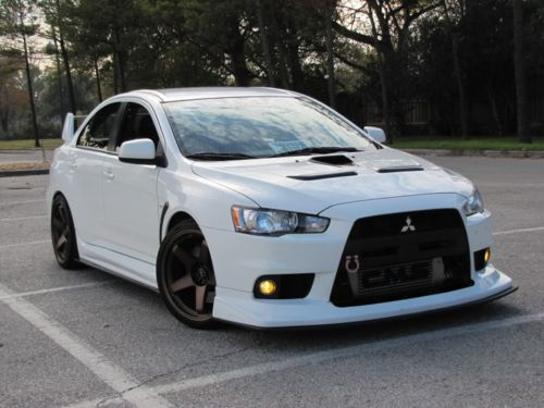 Mitsubishi EVO... I wish I could afford this for my amazing hubby!  He works so hard & gives everything.