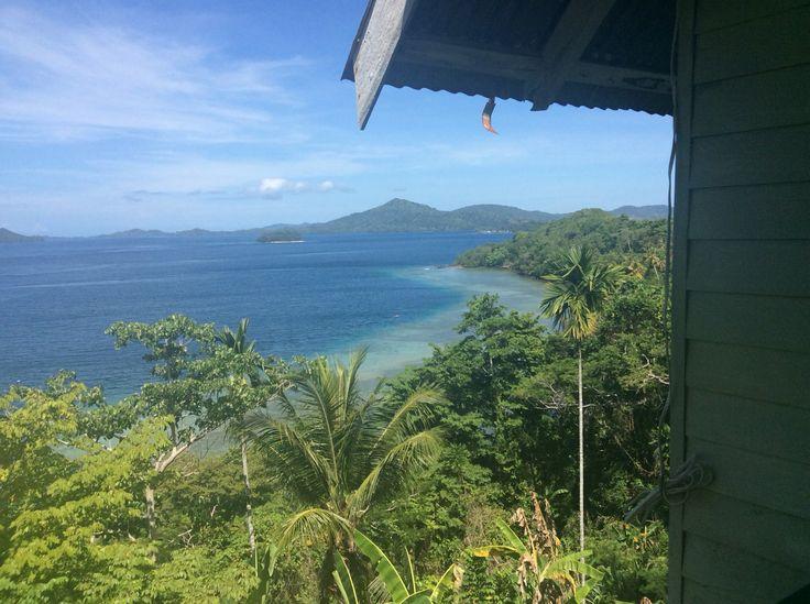 Ituah house looking out across the China Straits to Ebuma Island.  Kwato