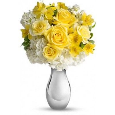 It's like sunshine and moonlight in are gloriously happy gift! Soft yellow roses, white hydrangea and other favorites showcased in a dazzling Silver Reflections vase. She'll love it