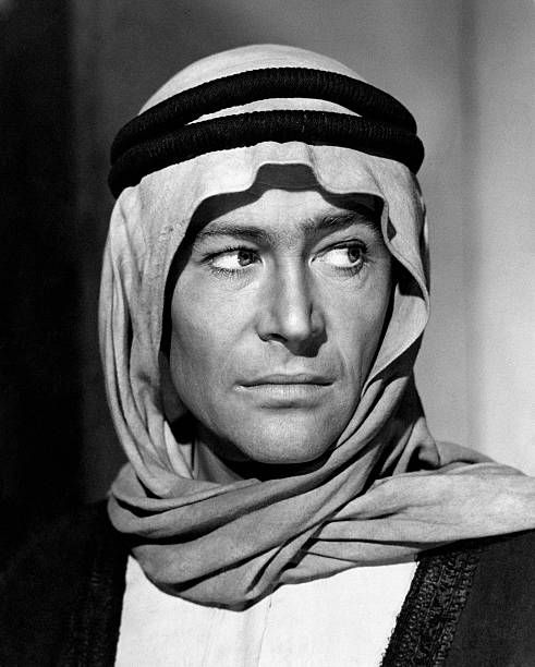 The Irish actor Peter O'Toole acting in the film Lawrence of Arabia. He is wearing a traditional Arabian head covering. 1962