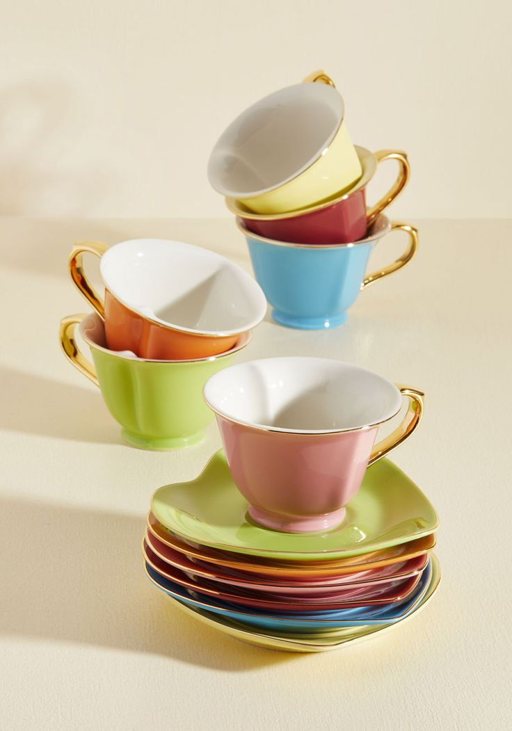Thank your friends for being so lovely by gathering them around this adorable teacup set for a gourmet fete! Garnished with golden trim and matching handles, this boxed set features six heart-shaped mugs and matching saucers in hues of cranberry, lemon, orange, rose, mint, and pale blueberry.