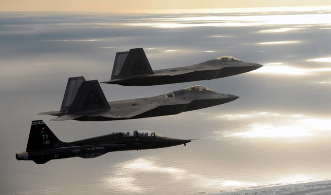 Two F-22 Raptors and a T-38 Talon from Tyndall AFB, Fla., fly together during a 43rd Fighter Squadron Basic Course training mission Oct. 7, 2013. Air Force photo by MSgt. J. Wilcox.