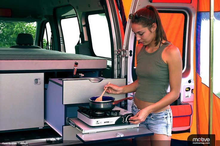 Ford Transit Connect w/ Camping Stove. Conversion idea: have weather proof canopy and side walls that roll and secure to top of van. Can create enclosure off back of van