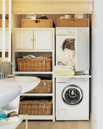 In the compact laundry workstation and storage area of a small bathroom, the stacked European-style washer-dryer set economizes space. A shelf between units pulls out for folding items fresh from the dryer, then slides out of sight. A matchstick shade lowers all the way to the floor, gracefully hiding the utility area when guests are expected.