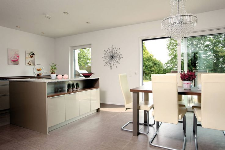 Modern, small, combined kitchen and dining room with bar stools and ...