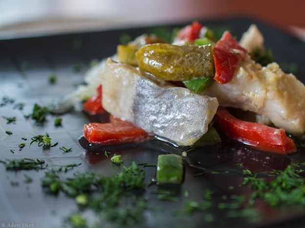Delicious herring in oil with vegetables