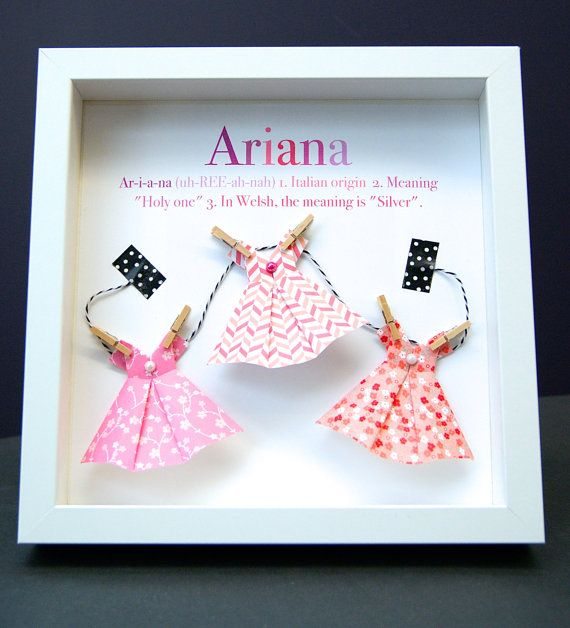 This personalized name shadowbox features beautiful hand-made origami dresses pinned to a clothesline with miniature clothespins, a perfect and unique gift for a newborn baby, birthday, or any special person! They are crafted with origami paper and mounted onto an acid-free cardstock.  These are made to order, with the basic design as shown, but they can be customized with any colour scheme you choose, so they can easily match any nursery or bedroom. Im always willing to work with a customer…