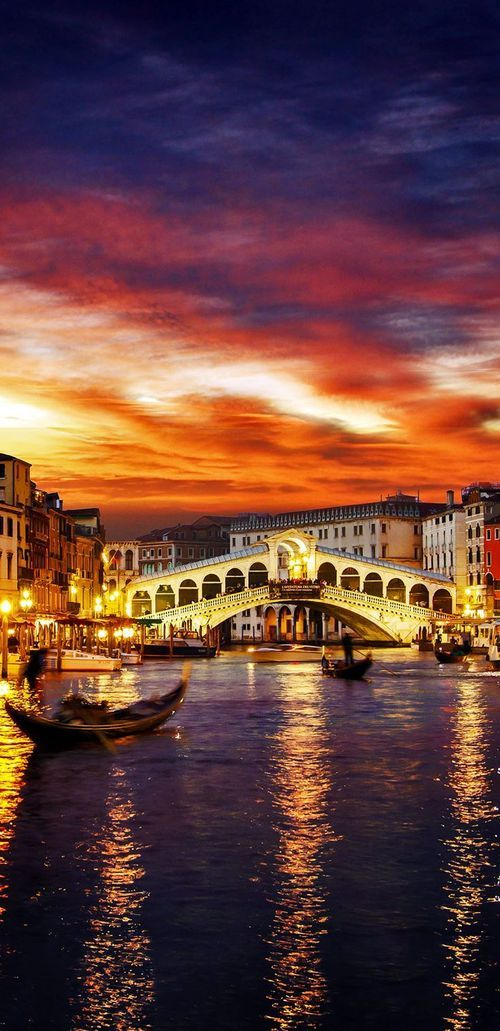 Ponte Rialto and gondola at sunset in Venice, Italy....we never got to see it at sunset but it waa still beautiful!