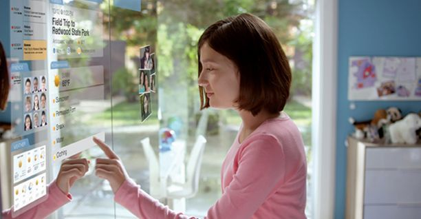 Corning Glass Technology  - Woman uses large touchscreen display that comprises bedroom closet door