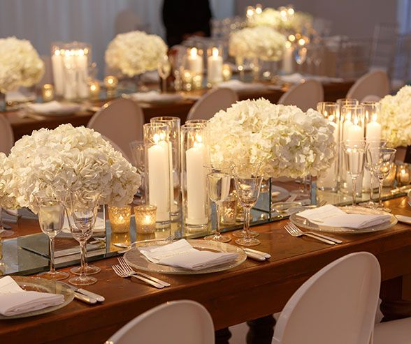 The Mirror Table Runner And Lots Of Candles Make All White Centerpiece More Glamorous