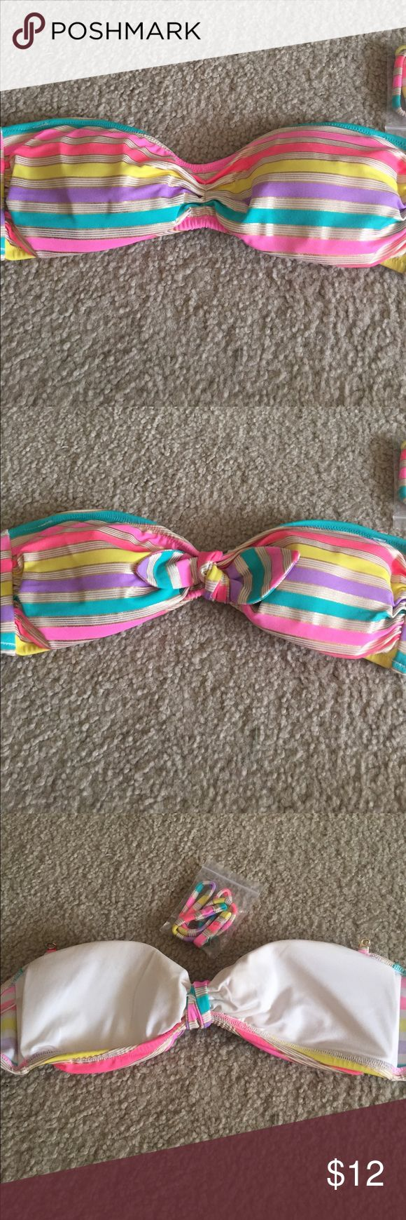 Victoria's Secret Multi Stripe Bandeau Top Size S Victoria's Secret Multi Stripe Bandeau Top. Includes light lining removable pads and strap to go over the neck. Good condition. Victoria's Secret Swim Bikinis