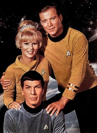 STAR TREK: William Shatner as Captain James T. Kirk with Leonard Nimoy as Science Officer Spock and Grace Lee Whitney as Yeoman Janice Rand.