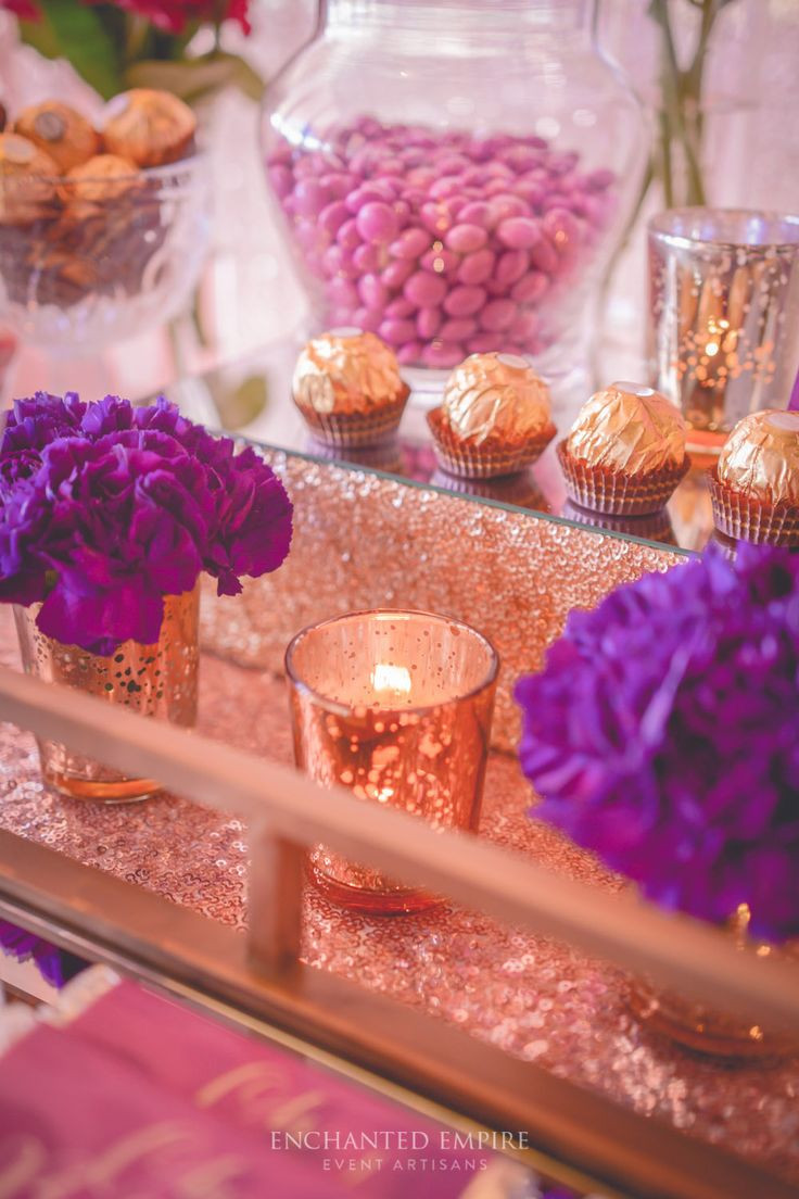 This gorgeous Plum + Gold Floral Baby Shower was the decadent style of the Dessert Table. Dressed in Rose gold sequin linen and rose gold sequin backdrop with lush deep magenta florals, gold mercury tealights and gold mirror trays. Our Graphics team created floral water colour patterns for the chocolate wraps, and dessert table accents. Plum+ Gold Floral Baby Shower Dessert Table. Youtube: https://www.youtube.com/watch?v=dIOCzUlngH8&feature=youtu.be