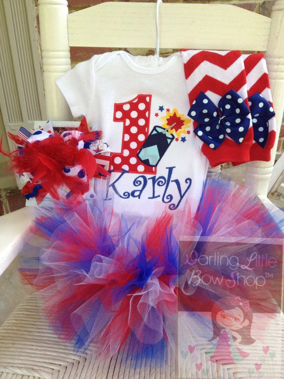Patriotic themed 1st Birthday tutu outfit.  Red, white and blue with firecracker.  Perfect for June/July babies.  www.darlinglittlebowshop.com