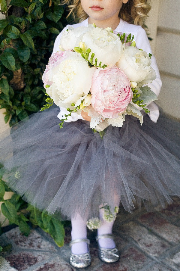 Flower girl wearing a grey tutu
