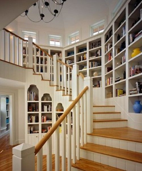 Bookshelves Winding Around A Staircase With Clerestory