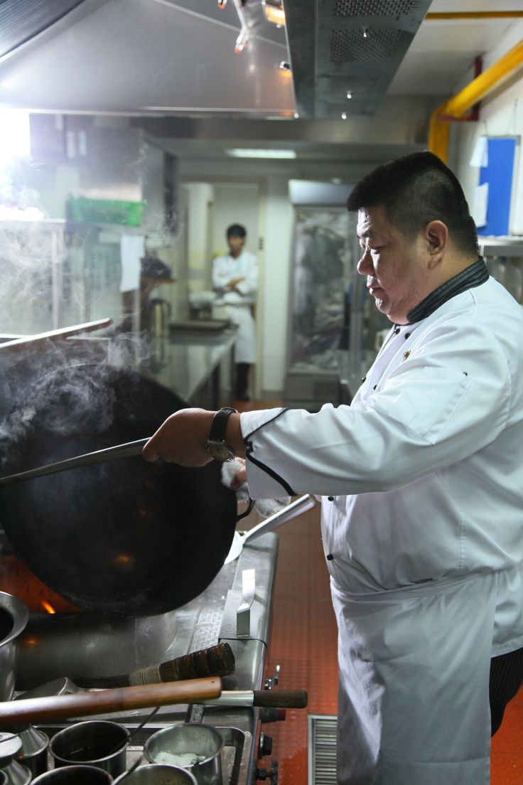 Heat the wok until it's hot and ready to cook up a storm! #giveaway #prize #contest #hangzhou #china #foodie #recipe #dishes #specialty #cuisine #food #orange #shrimp #longjingtea #tea #shrimp #seafood #savory #delights