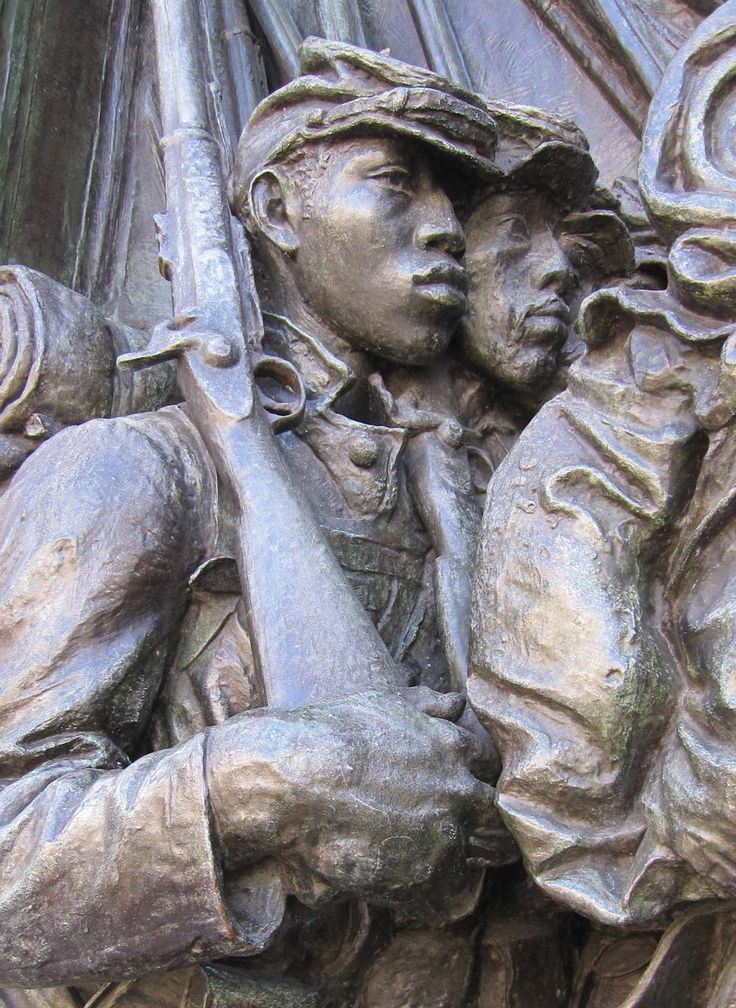 On Boston Common, at the corner of Beacon and Park streets, stands what many consider to be the greatest public sculpture in the United States. The high-relief bronze memorial (detail shown) created by sculptor Augustus Saint-Gaudens honors Colonel Robert Gould Shaw and the African American soldiers of the 54th Massachusetts Regiment. It took Saint-Gaudens almost 14 years to complete his tribute.