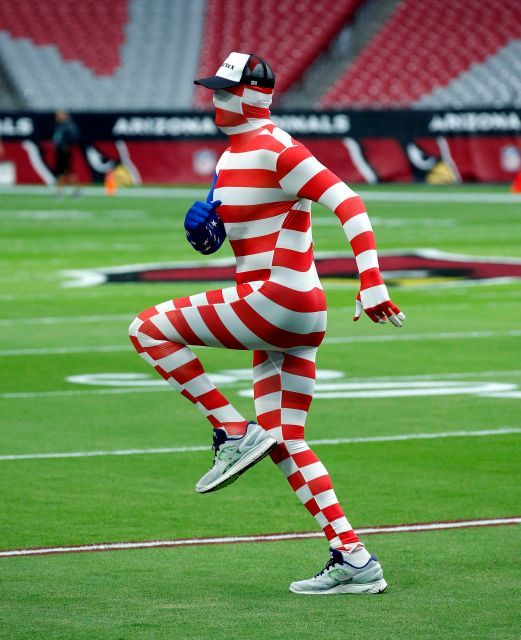 49ers vs. Cardinals:  23-20, Cardinals  -  November 13, 2016  -    Arizona Cardinals quarterback Carson Palmer takes the field prior to an NFL football game against the San Francisco 49ers, wearing a body suit after losing the weekly quarterback challenge, Sunday, Nov. 13, 2016, in Glendale, Ariz.