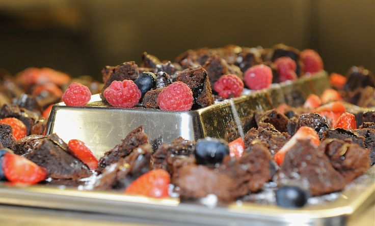 We offer a whole host of delicious dessert. These are our homemade chocolate fudge brownies served with fresh fruit!