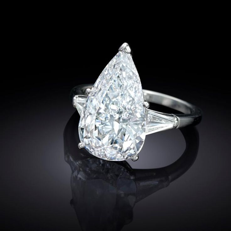6.04 carat pear-shape diamond ring with an estimate of $100,000-150,000. The jewellery of Jackie Collins that went up for auction. Iconic in style and design these vintage and antique jewels were much loved from her estate. http://www.thejewelleryeditor.com/whats-on/auctions/jackie-collins-auction-jewelry-bonhams/ #jewelry