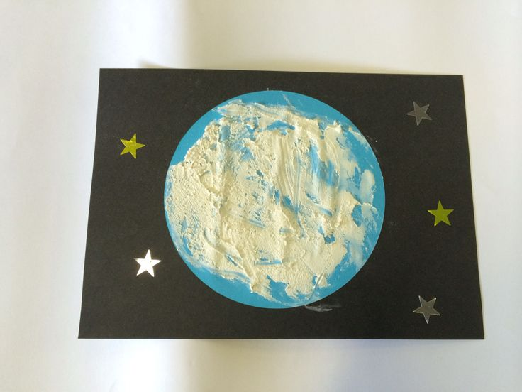 "Moon craft made by gluing a ""kinder circle"" onto black paper and spreading it with a flour/white paint mixture. Star stickers are also put onto paper."