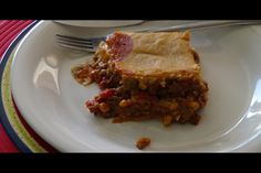 This tamale pie recipe is a delicious Tex-Mex casserole made with beef and a beautiful masa harina crust. Masa harina is very finely ground corn flour.
