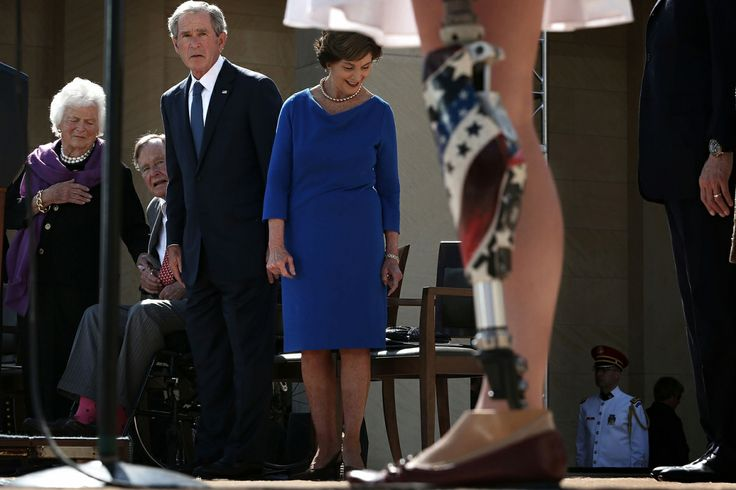 Alex Wong // April 25, 2013. U.S. Army 1st Lt. Melissa Stockwell (Ret.) (R), who was the first female American soldier to lose a limb in the war in Iraq, recites the Pledge of Allegiance as (L-R) former U.S. First Lady Barbara Bush, former President George H.W. Bush, former President George W. Bush and former First Lady Laura Bush look on during the opening ceremony of the George W. Bush Presidential Center in Dallas, Texas.