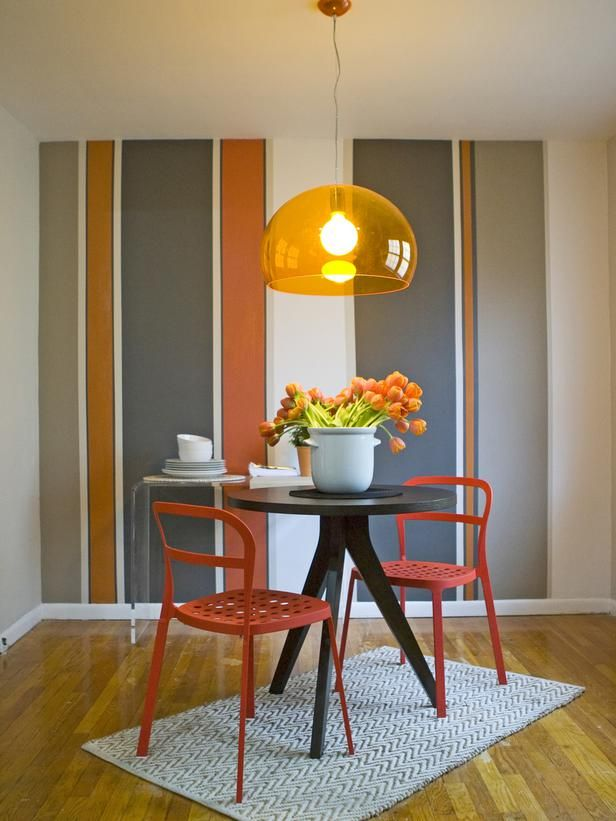 The Kitchen Cousins used a carrot-hued light fixture and playful wall stripes to liven up this home's dining area.  (http://www.hgtv.com/on-tv/dazzling-kitchen-transformations-from-kitchen-cousins/pictures/page-29.html?soc=Pinterest)