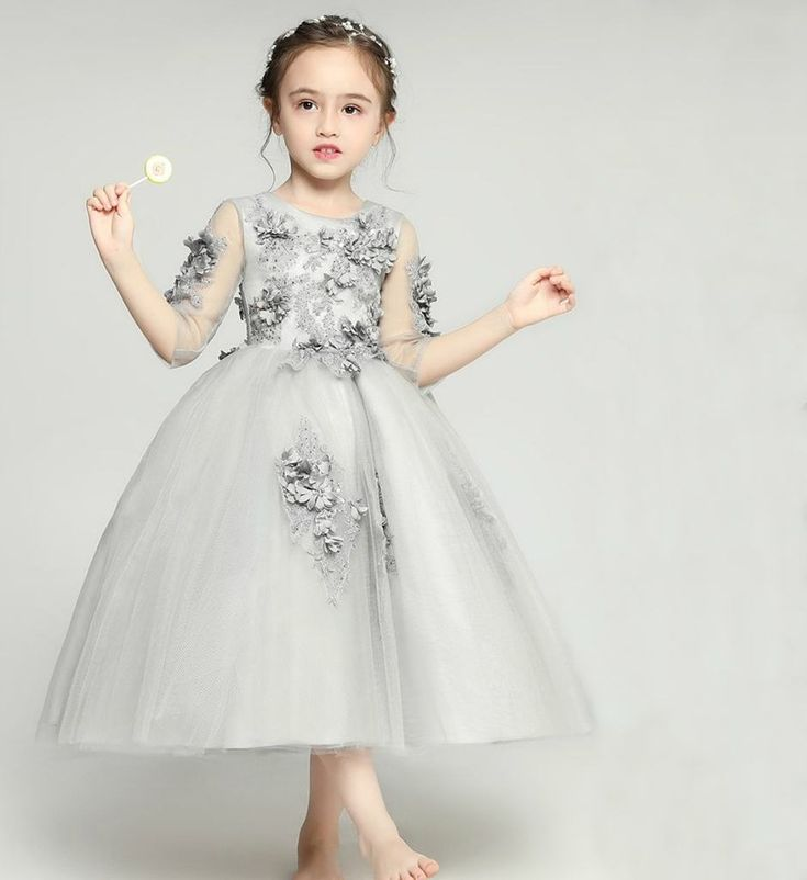 Floral Dress-Made To Order - High Quality Beautiful Round Neckline Sheer Half Sleeve Ankle - Floor Length Infant Toddler Little & Big Flower Girl Gown. Available from 2 -15 years. Material: Tulle mesh & cotton. Color: White. Please do compare your  little girl measurements with our size chart below or you may leave a note your little girl's height, bust and waist measurements so we can process it and send you the right size.