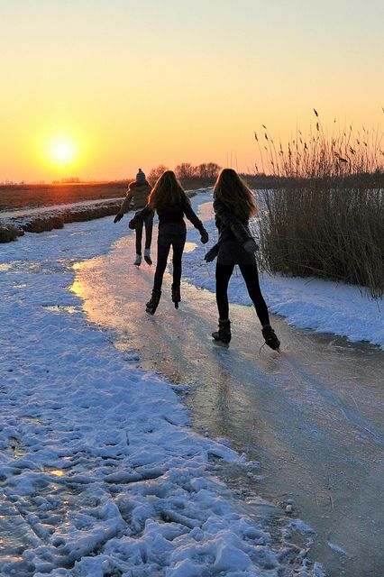 Ice skating girls at sunset in Delft, The Netherlands.
