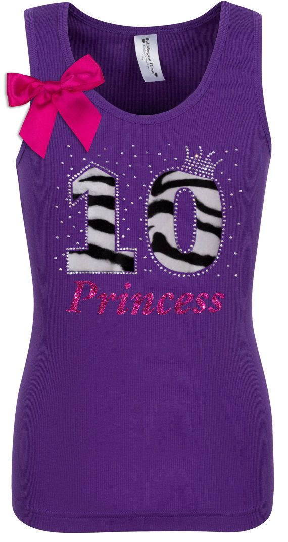 "10th Birthday Purple Zebra Tank Top! Our zebra fabric design on our 10th Birthday tank top is the perfect outfit for your daughters big day! This top offers a stretchy fabric blend that is comfy for girls to wear, Ive added fun colorful ribbon, a heart and a Princess Crown to top off the design. Enjoy!  Purchase Everything or only the items you select.  Items To Purchase • Tank • Tutu • Zebra Hair Bow • Add A Name  Make It Special: add ""Birthday Girl"", Princess or a ""Name"" for only $10.00…"