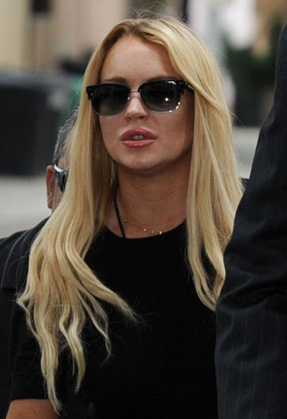 Lindsay Lohan Photos Photos - Actress Lindsay Lohan attends a probation revocation hearing at the Beverly Hills Courthouse on July 6, 2010 in Los Angeles, California. Lindsay Lohan was put on probation for her August 2007 no-contest plea to drug and alcohol charges stemming from two separate traffic accidents, but the probation was revoked in May 2010 after missing a scheduled hearing. - Lindsay Lohan Probation Hearing
